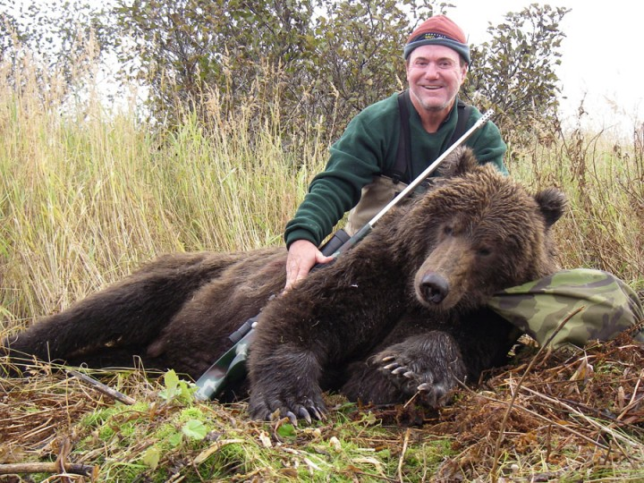 Hunter with his large bear taken during Arctic North Guides hunt.