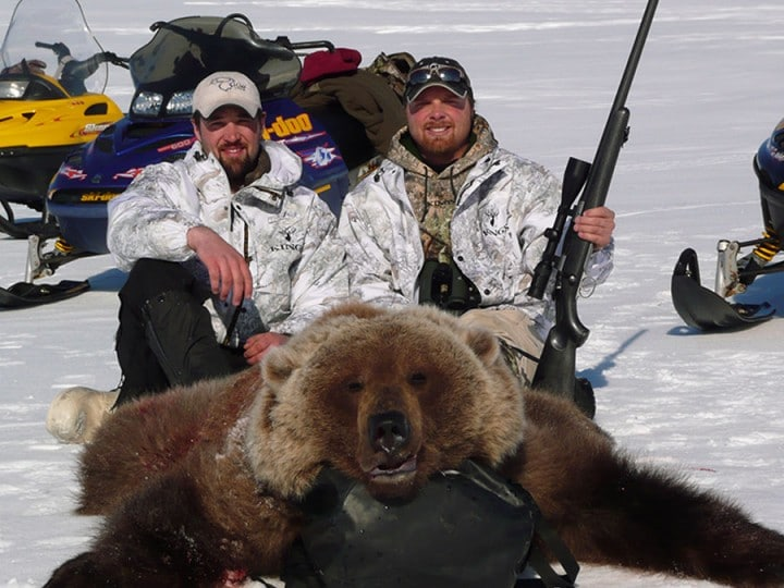 Two hunters with Spring bear hunting Arctic North Guides.