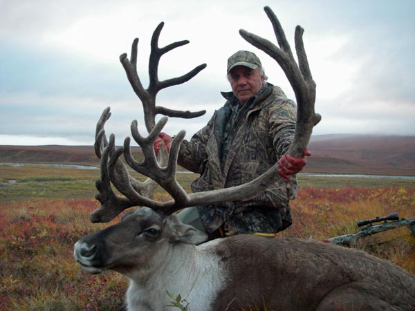 Hunter with Caribou, Arctic North Guides.